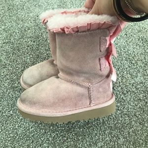 Pink Ugg boots with bows